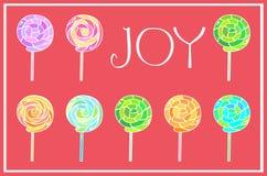 Christmas card. Joy and lollipops Stock Photos