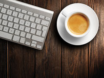 Christmas card. Keyboard, cup of coffee. background Stock Photo