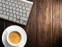 Christmas card. Keyboard, cup of coffee. background Royalty Free Stock Images