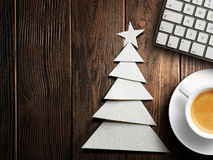 Christmas card. Keyboard, cup of coffee and Christmas tree made of paper Royalty Free Stock Photography