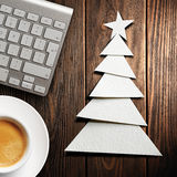 Christmas card. Keyboard, cup of coffee and Christmas tree made of paper Royalty Free Stock Photos