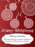 Christmas card with lace balls. In the dark red background Royalty Free Stock Photo