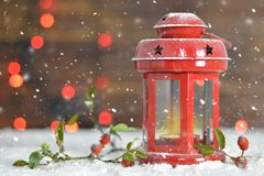 Christmas card with Christmas lantern on wooden background Stock Images