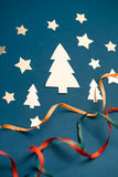 Christmas card made of cut out glossy paper christmas trees and Royalty Free Stock Photos