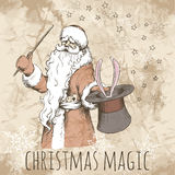 Christmas card with magic Santa. Hand drawn sketch of magic Santa Claus. Illusionist with a rabbit in a hat and with a magic wand on the old paper background Stock Photo