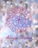 Christmas card with mandala. Festive christmas card with hand drawn decorated mandala, snowflakes and calligraphy text Merry Christmas on the colorful background Stock Photo
