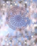 Christmas card with mandala. Festive christmas card with hand drawn decorated mandala, snowflakes and calligraphy text Merry Christmas on the colorful background Stock Images