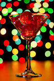 Christmas card: martini glass with balls on bokeh background Stock Photo