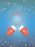 Christmas card with mittens. Christmas greeting card with mittens on blue background. Knitted red mittens with a rope in the shape of  bow. Christmas and New Stock Image