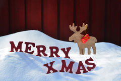 Christmas Card With Moose And Gift, Snow, Merry Xmas Royalty Free Stock Photography