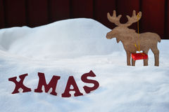 Christmas Card With Moose And Gift, Snow, Xmas Royalty Free Stock Photography