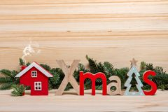 Christmas card. New Year`s town, houses, wooden letters Christmas, stock photography