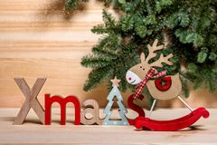 Christmas card. New Year`s town, wooden deer toy, wooden letters Christmas, stock images
