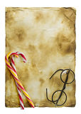 Christmas card. Old paper on a wooden background with Christmas sweets stock photo