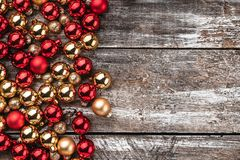 Christmas card. Old wood background, half full of baubles. And another space for a greeting message. Top view. Xmas card stock photography