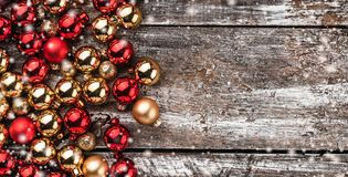 Christmas card. Old wood background, half full of baubles. And another space for a greeting message. Top view. Xmas card. Effect snowflakes stock images