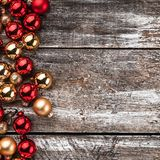 Christmas card. Old wood background, half full of baubles. And another space for a greeting message. Top view. Xmas card. Xmas square card stock photography