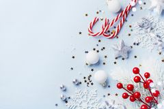 Free Christmas Card Or Banner. Christmas Silver Decorations On Blue Background Royalty Free Stock Images - 132511259