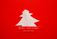 Christmas card with origami Christmas decoration. Stock Images