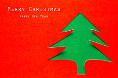 Christmas card with origami Christmas decoration. Stock Image