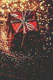 Christmas card with ornament, red present and golden sparkling Stock Images