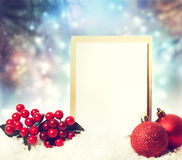 Christmas card with ornaments. Christmas card with red ornaments on the snow Royalty Free Stock Photography