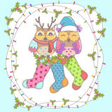Christmas card with owls and Christmas socks Stock Photos