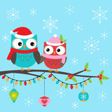 Christmas card with owls Stock Photos