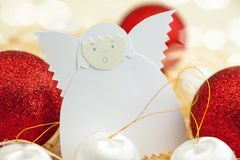 Christmas card with paper angel and balls stock image