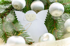Christmas card with paper angel, balls and spruce twig Royalty Free Stock Photo
