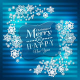 Christmas card. Paper snowflakes on blue Royalty Free Stock Image