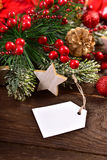 Christmas card with paper tag for greetings Royalty Free Stock Photo