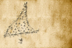 Christmas Card, parchment gold fir. Christmas Card, parchment christmas tree sepia golden drops Stock Images