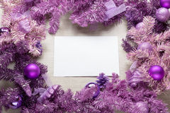 Christmas card parchment over fir tree Royalty Free Stock Images
