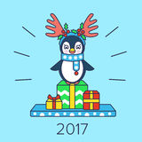 Christmas card with a penguin and gifts. 2017 Royalty Free Stock Images
