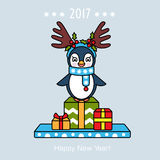 Christmas card with a penguin and gifts. 2017 Stock Image