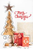Christmas card with pine tree wood carving and box gift. Traditional Christmas card with merry Christmas text. Christmas card photo with hand drawings stock images