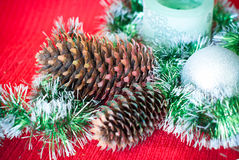 Christmas card with pine cones Royalty Free Stock Photos