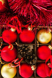 Christmas card with pine cones and balls Royalty Free Stock Images