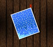Christmas Card Pinned on Wood. Royalty Free Stock Image