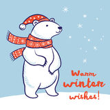 Christmas card of polar bear in red scarf and hat Stock Images