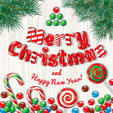 Christmas card poster banner with fir branches and candies on a wooden background. Vector illustration. Stock Images