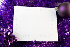 Christmas card with purple decorations Stock Photo