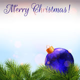 Christmas card. Realistic fir branches and christmas bauble. Christmas card. Realistic fir branches and blue christmas bauble with bokeh effect. The words `Merry Royalty Free Stock Photos