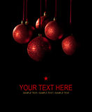 Christmas card - red balls on black background Royalty Free Stock Images