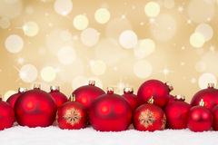 Christmas card red balls decoration with golden background Royalty Free Stock Image