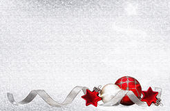Christmas background with red balls and stars. Christmas card with red balls, stars and silver ribbon on bright white background - computer generated Royalty Free Stock Photography