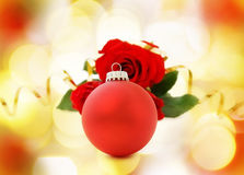 Christmas card with red bauble and roses Royalty Free Stock Photo