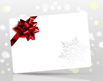 Christmas card with red bow. Christmas or New Year background with blank card and red bow Stock Photography