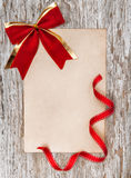 Christmas card with red bow and ribbon Royalty Free Stock Photography